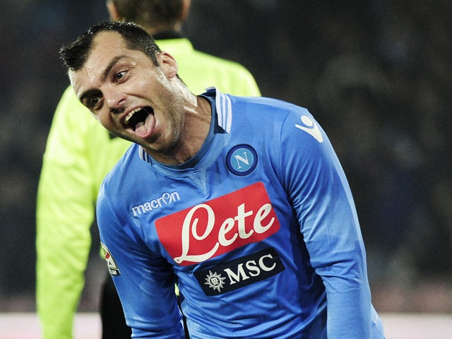 Napoli's forward Goran Pandev celebrates after scoring during the Italian Serie A football match SSC Napoli vs Udinese at San Paolo Stadium in Naples on December 7, 2013