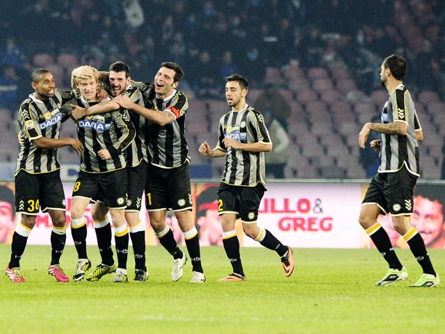 Udinese's players celebrate after scoring the Italian Serie A football match SSC Napoli vs Udinese at the San Paolo Stadium in Naples on December 7, 2013
