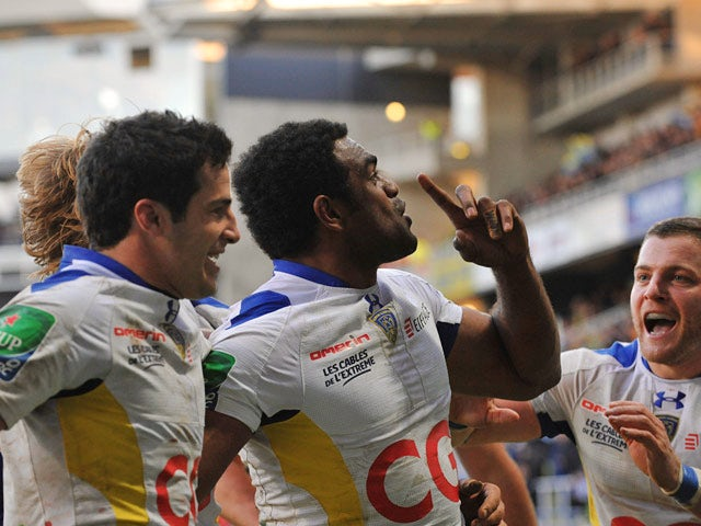 Clermont-Auvergne's Napolioni Nalaga celebrates with teammates after scoring a try against Llanelli Scarlets during their Heineken Cup match on December 7, 2013