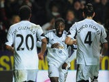 Swansea's Nathan Dyer scores his team's opening goal against Newcastle during their Premier League match on December 4, 2013