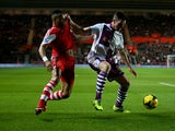 Southampton's Nathaniel Clyne and Aston Villa's Ciaran Clark in action during their Premier League match on December 4, 2013