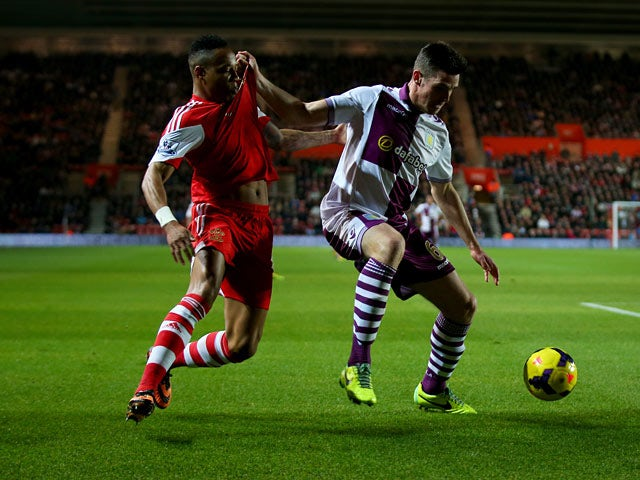 Southampton's Nathaniel Clyne and Aston Villa's Ciaran Clark in action during their Premier League match on December 4, 2013