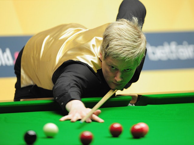 Neil Robertson in action during his first round match against Robert Milkins during their World Snooker Championship on April 25, 2013