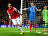 Arsenal's Nicklas Bendtner celebrates after scoring the opening goal against Hull during their Premier League match on December 4, 2013