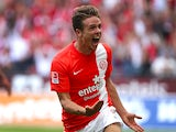 Mainz' Nicolai Mueller celebrates after scoring against Stuttgart during their Bundesliga match on August 11, 2013