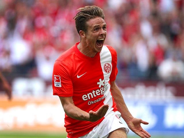 Mainz' Nicolai Mueller celebrates after scoring against Stuttgart during their Bundesliga match on August 11, 2013