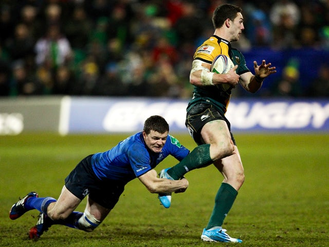Brian O'Driscoll of Leinster tackles George North of Northampton during the Heineken Cup match between Northampton Saints and Leinster Rugby at Franklin's Gardens on December 7, 2013