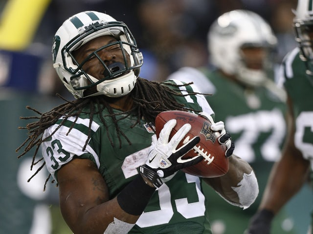 Chris Ivory #33 of the New York Jets celebrates his touchdown against the Oakland Raiders during their game at MetLife Stadium on December 8, 2013