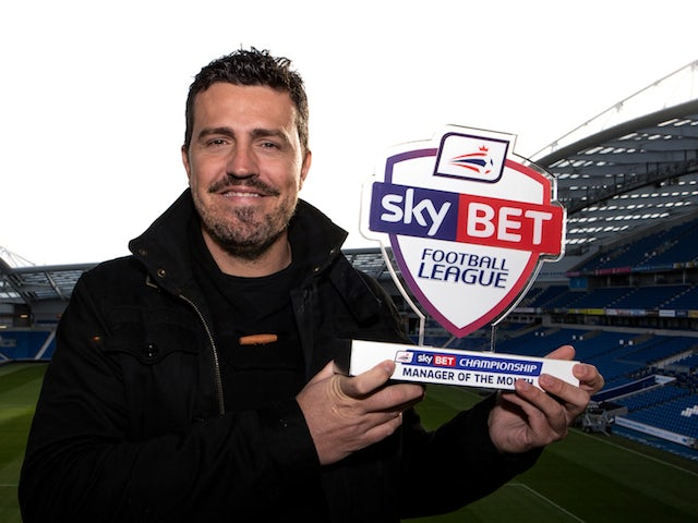 Brighton manager Oscar Garcia with his November Manager Month award on December 5, 2013