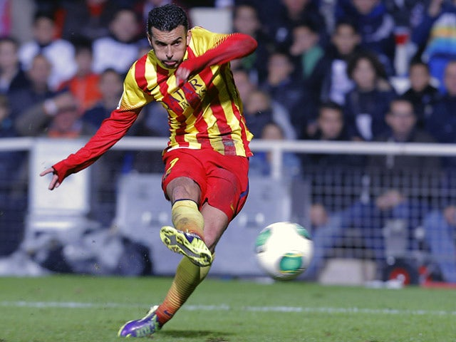 Barcelona's Pedro Rodriguez scores his team's opening goal against Cartagena during their Copa del Rey match on December 6, 2013