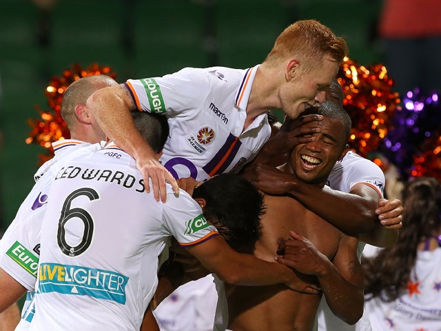 Sidnei Sciola Moraes of the Glory celebrates with team mates after kicking a goal during the round nine A-League match between Perth Glory and the Wellington Phoenix at nib Stadium on December 6, 2013