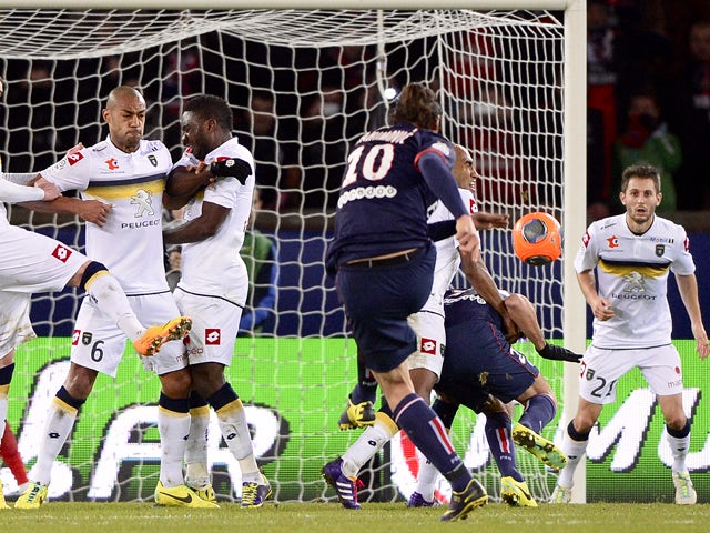 Paris Saint-Germain's Swedish forward Zlatan Ibrahimovic scores during the French L1 football match between Paris Saint-Germain (PSG) and Sochaux at the Parc des Princes Stadium in Paris on December 7, 2013