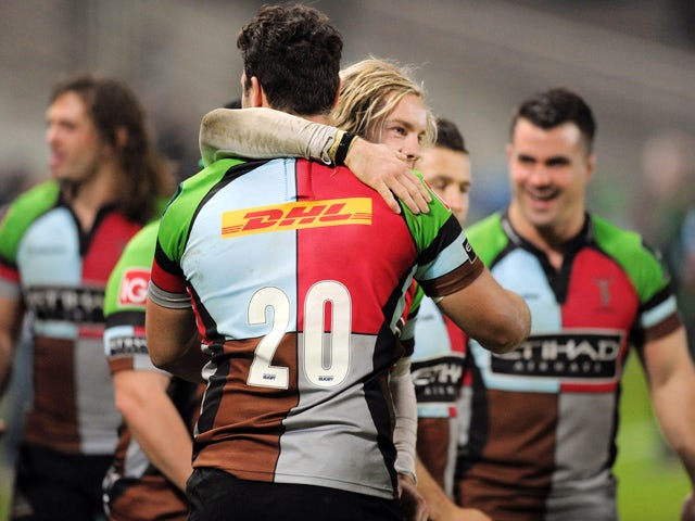 Harlequins' winger Tom Williams (C) celebrates with his teammate Harlequins' flanker Joe Trayfoot (C-back) at the end of the European Cup rugby union match between Racing Metro 92 and Harlequins on December 7, 2013