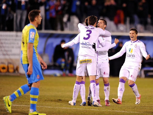 Real Jaen CF players celebrate after scoring their 2nd goal during the Copa del Rey, Round of 32 match between Real Jaen CF and RCD Espanyol at estadio Municipal La Victoriaon December 8, 2013