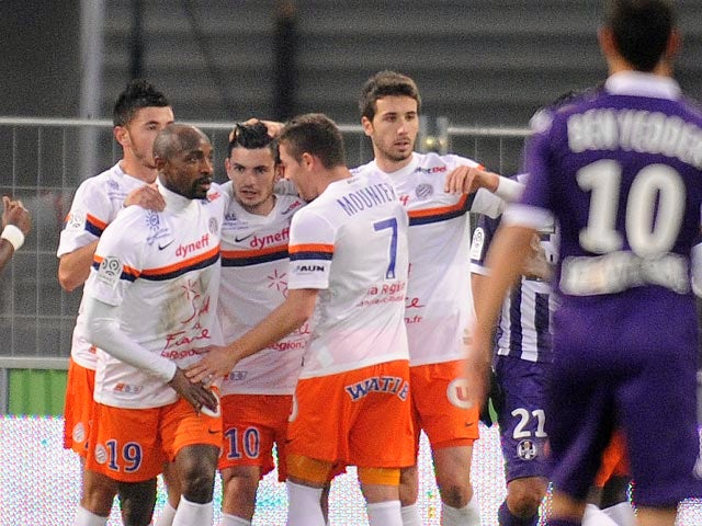 Montpellier's Remy Cabella celebrates with teammates after scoring the opening goal against Toulouse during their Ligue 1 match on December 8, 2013