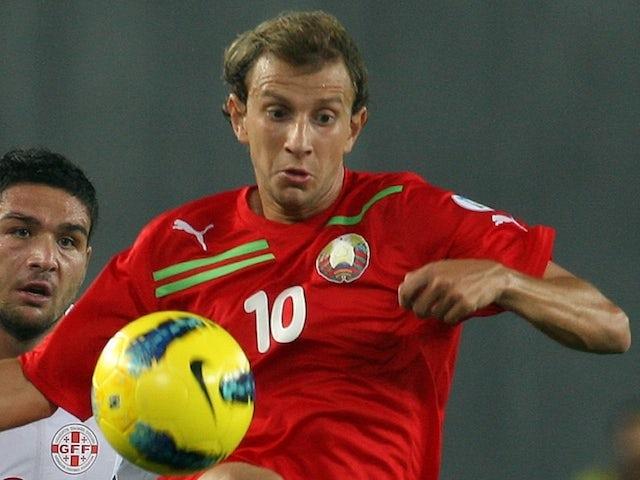 Belarus's Renan Badrin Bressan vies with Georgia's Murtaz Daushvili during their FIFA 2014 World Cup qualifying match in Tbilisi, on September 7, 2012
