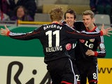 Bayer Leverkusen's Robbie Kruse is congratulated by teammates after scoring the opening goal against Freiburg during the 3rd round of the German Cup on December 4, 2013