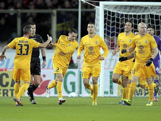 Hellas Verona's Romulo celebrates after scoring his team's opening goal against Fiorentina during their Serie A match on December 2, 2013