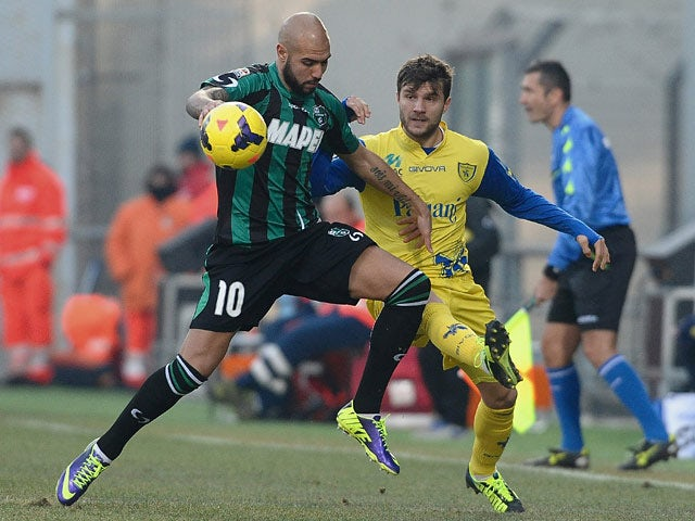 Sassuolo Calcio's Simone Zaza and Chiveo Verona's Peraprim Hetemaj in action during their Serie A match on December 8, 2013