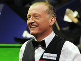 Steve Davis of England smiles during his match against Mark King of England during the Betfred.com World Snooker Championships at the Crucible Theatre on April 20, 2010