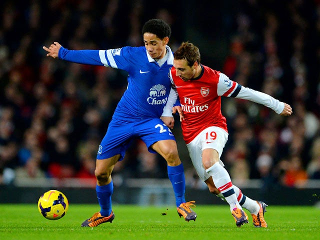 Everton's Steven Pienaar and Arsenal's Santi Cazorla in action during their Premier League match on December 8, 2013