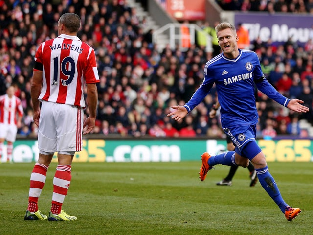 Andre Schurrle of Chelsea celebrates after scoring their first goal during the Barclays Premier League match between Stoke City and Chelsea at Britannia Stadium on December 7, 2013