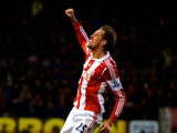Peter Crouch of Stoke celebrates after scoring a goal to level the scores at 1-1 during the Barclays Premier League match between Stoke City and Chelsea at Britannia Stadium on December 7, 2013