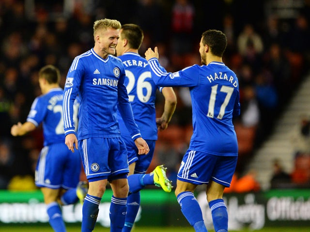 Goalscorer Andre Schurrle of Chelsea celebrates with teammate Eden Hazard after scoring his team's second goal during the Barclays Premier League match between Stoke City and Chelsea at Britannia Stadium on December 7, 2013