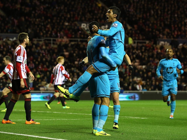 Paulinho of Tottenham celebrates his goal with team mate Nacer Chadli during the Barclays Premier League match between Sunderland and Tottenham Hotspur at the Stadium of Light on December 7, 2013