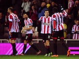 Adam Johnson of Sunderland celebrates scoring the opening goal with team-mate Jozy Altidore during the Barclays Premier League match between Sunderland and Tottenham Hotspur at Stadium of Light on December 07, 2013