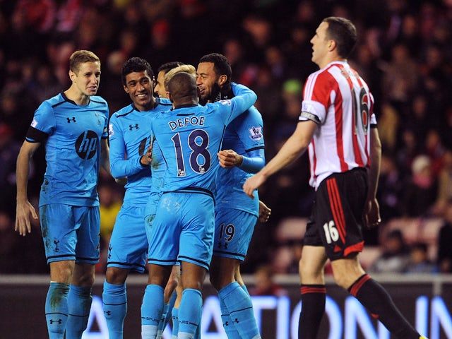 Moussa Dembele of Tottenham Hotspur celebrates with his team-mates after John O'Shea of Sunderland scored an own goal during the Barclays Premier League match between Sunderland and Tottenham Hotspur at Stadium of Light on December 07, 2013