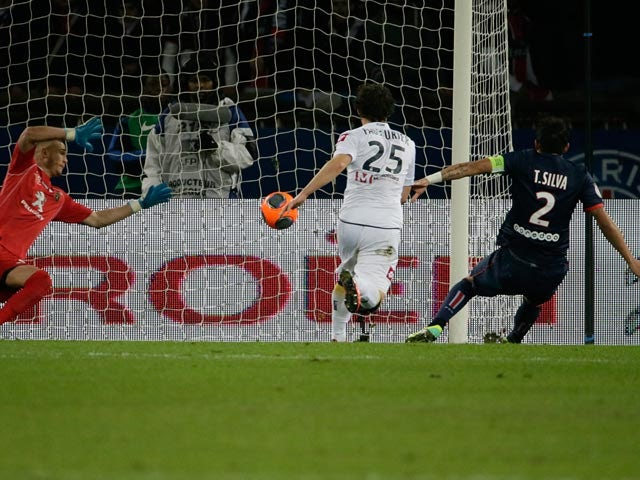 PSG's Thiago Silva scores the opening goal against Sochaux during their Ligue 1 match on December 7, 2013