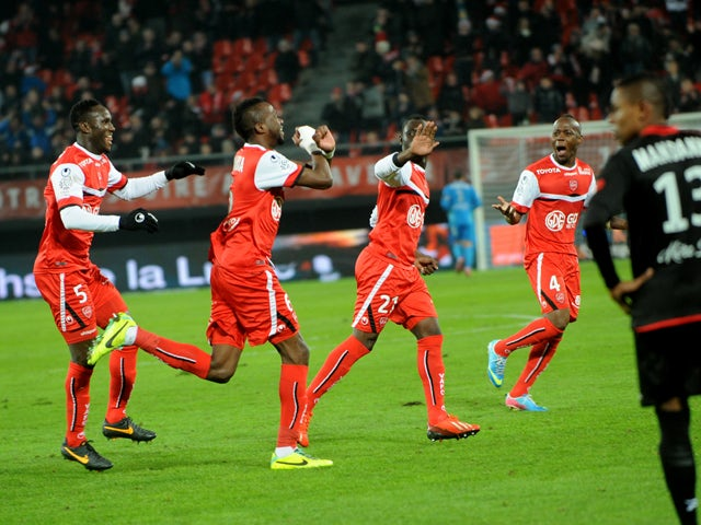 Valenciennes' Tongo Doumbia celebrates after scoring a goal during the French L1 football match Valenciennes vs Guingamp at Hainaut stadium in Valenciennes on December 7, 2013