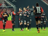 Guingamp's French forward Cedric Faure (C) celebrates after scoring a goal during the French L1 football match between Valenciennes and Guingamp at Stade Du Hainaut in Valenciennes on December 7, 2013