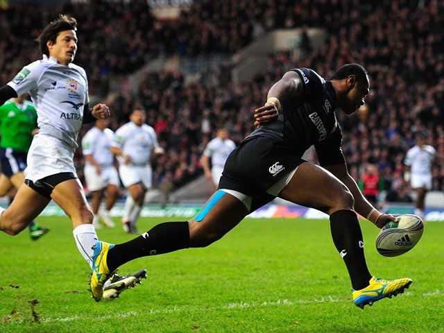 Leicester Tigers' Vereniki Goneva scores the opening try against Montpellier during their Heineken Cup match on December 8, 2013