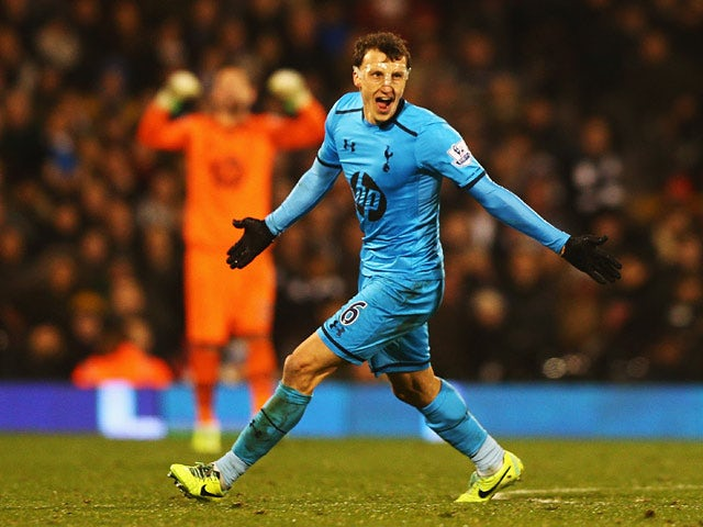Tottenham's Vlad Chiriches celebrates after scoring his team's opening goal against Fulham during their Premier League match on December 4, 2013
