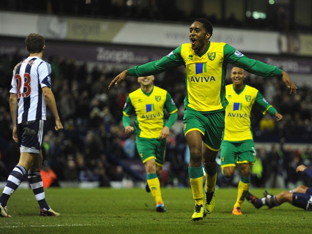 Norwich player Leroy Fer celebrates after scoring the second goal during the Barclays Premier League match between West Bromwich Albion and Norwich City at The Hawthorns on December 7, 2013