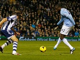 Man City's Yaya Toure scores his team's second goal against West Brom during their Premier League match on December 4, 2013