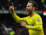 Newcastle's Yohan Cabaye celebrates after scoring the opening goal against Man United during their Premier League on December 7, 2013