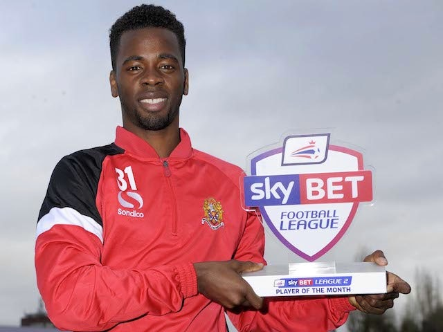 Dag & Red striker Zavon Hines with his League Two Player of the Month award on December 5, 2013