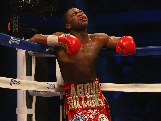 Adrien Broner rests in the corner against Marcos Maidana during their WBA Welterweight Title bout at Alamodome on December14, 2013