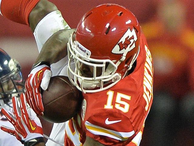 Wide receiver A.J. Jenkins #15 of the Kansas City Chiefs makes a catch against Denver Broncos on December 14, 2013