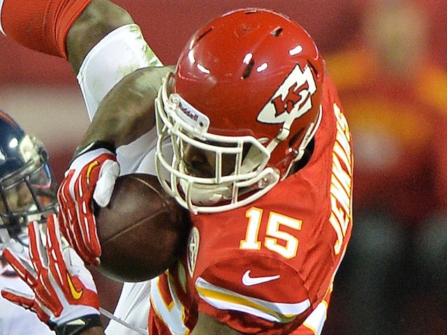 Wide receiver A.J. Jenkins #15 of the Kansas City Chiefs makes a catch against Denver Broncos on December 14, 2013
