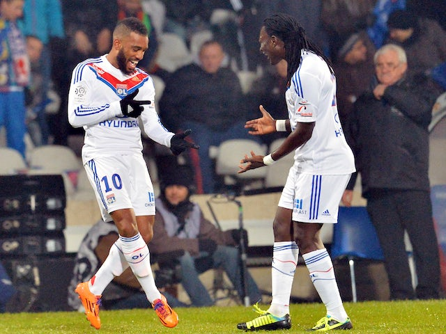 Lyon's French forward Alexandre Lacazette celebrates with Bafetimbi Gomis after scoring a goal during the French L1 football match against Marseille on December 15, 2013