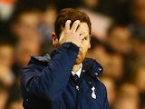 Andre Villas-Boas manager of Tottenham Hotspur looks through his hands during the Barclays Premier League match between Tottenham Hotspur and Liverpool on December 15, 2013