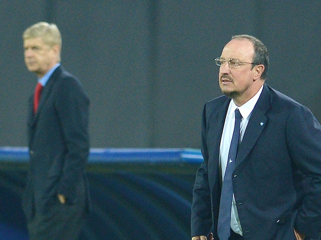 Arsenal's French manager Arsene Wenger and Napoli's Spanish coach Rafael Benitez look on during the UEFA Champions League group F football match between their sides on December 11, 2013