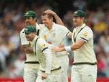 Peter Siddle of Australia celebrates after dismissing Matt Prior of England with Mitchell Johnson, Michael Clarke and Shane Watson during day five of Second Ashes Test Match between Australia and England at Adelaide Oval on December 9, 2013