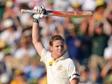 Australia's batsman Steven Smith raises his bat as he reaches his 100 on day one of the third Ashes cricket Test against England in Perth on December 13, 2013