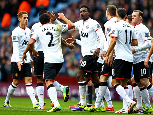 Danny Welbeck of Manchester United is by congratulated by Rafael da Silva and team mates as he scores their first goal during the Barclays Premier League match between Aston Villa and Manchester United at Villa Park on December 15, 2013