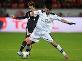 Leverkusen's Australian midfielder Robbie Kruse and Frankfurt's Peruvian defender Carlos Zambrano vie for the ball during the German first division Bundesliga football match Bayer Leverkusen vs Eintracht Frankfurt in the German city of Leverkusen on Decem